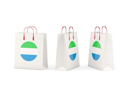 sierra leone: Round flag of sierra leone on shopping bags. 3D illustration