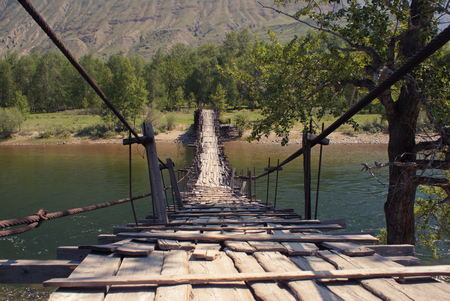 altay: Bridge through Chulyshman river, Altay mountains.