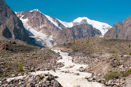 aktru: Sprign starts from Small Aktru glacier. Altay mountains.