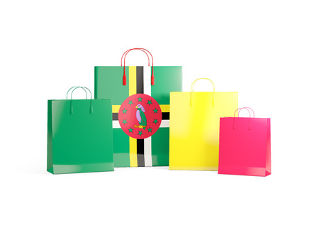 Flag of dominica on shopping bags. 3D illustration Stock Photo