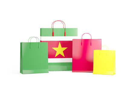 Flag of suriname on shopping bags. 3D illustration