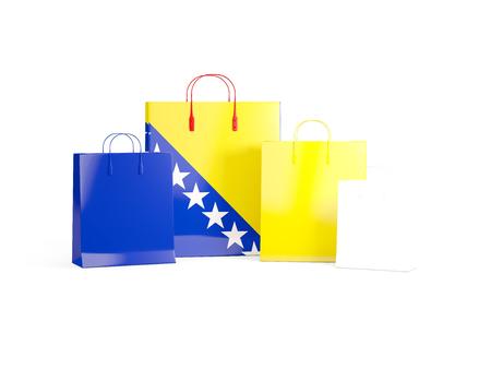 Flag of bosnia and herzegovina on shopping bags. 3D illustration