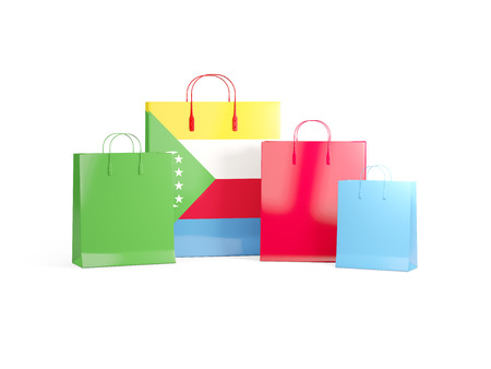 Flag of comoros on shopping bags. 3D illustration Stock Photo