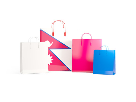 Flag of nepal on shopping bags. 3D illustration