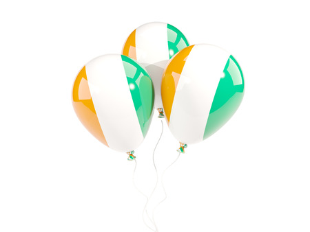 Three balloons with flag of cote d Ivoire isolated on white. 3D illustration