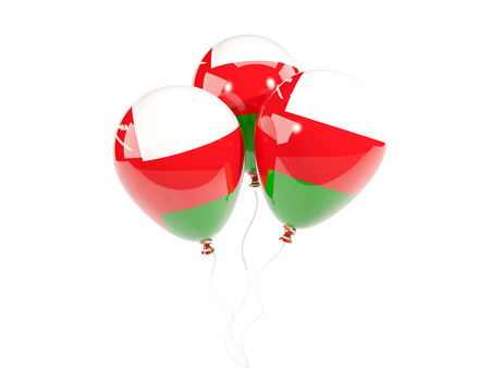 Three balloons with flag of oman isolated on white. 3D illustration Stock Photo