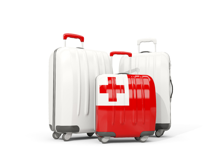Luggage with flag of tonga. Three bags isolated on white. 3D illustration