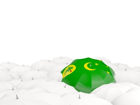 Umbrella with flag of cocos islands isolated on white. 3D illustration Stock Photo