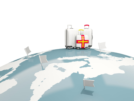 guernsey: Luggage with flag of guernsey. Three bags on top of globe. 3D illustration Stock Photo