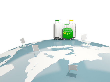 Luggage with flag of cocos islands. Three bags on top of globe. 3D illustration