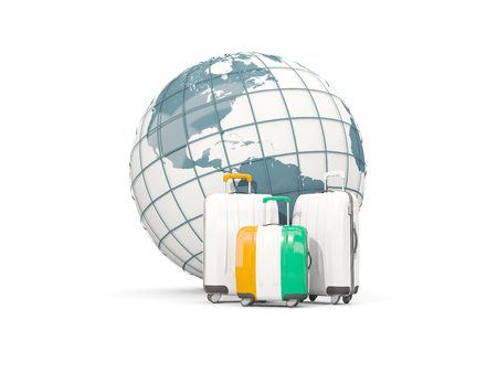 Luggage with flag of cote d Ivoire. Three bags in front of globe. 3D illustration Stock Photo