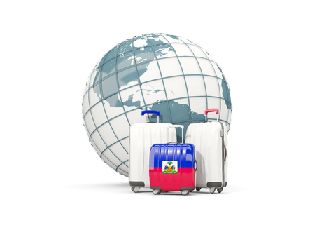 Luggage with flag of haiti. Three bags in front of globe. 3D illustration Stock Photo