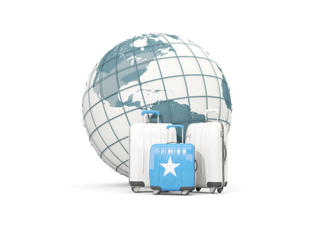 Luggage with flag of somalia. Three bags in front of globe. 3D illustration