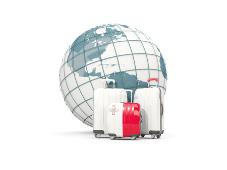 Luggage with flag of malta. Three bags in front of globe. 3D illustration Stock Photo