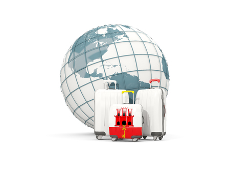 Luggage with flag of gibraltar. Three bags in front of globe. 3D illustration