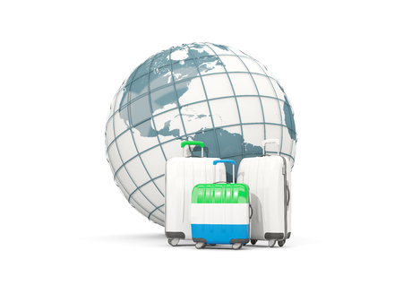 Luggage with flag of sierra leone. Three bags in front of globe. 3D illustration