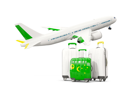Luggage with flag of cocos islands. Three bags with airplane isolated on white. 3D illustration