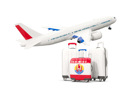 Luggage with flag of french polynesia. Three bags with airplane isolated on white. 3D illustration Stock Photo