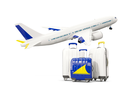 tokelau: Luggage with flag of tokelau. Three bags with airplane isolated on white. 3D illustration