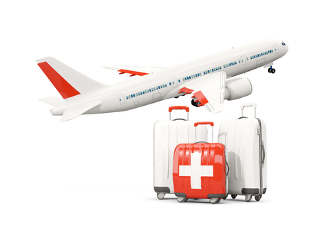 Luggage with flag of switzerland. Three bags with airplane isolated on white. 3D illustration