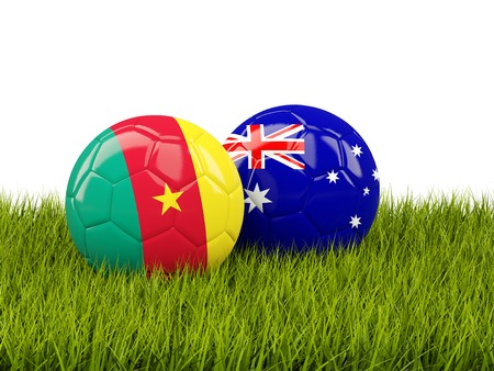 cameroon: Two footballs with flags of Cameroon and Australia on green grass. 3D illustration Stock Photo