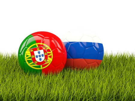Two footballs with flags of Portugal and Russia on green grass. 3D illustration