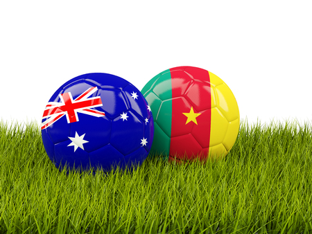 cameroon: Two footballs with flags of Australia and Cameroon  on green grass. 3D illustration Stock Photo