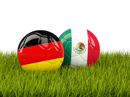3d ball: Germany and Mexico soccer balls on grass. 3D illustration