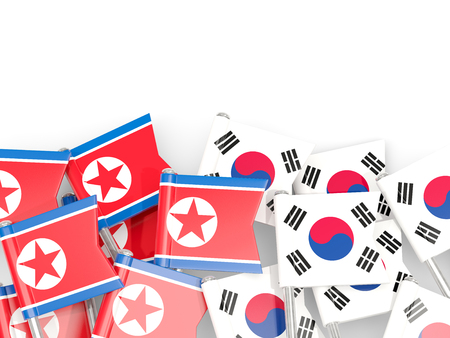 Flag pins of North Korea (DPRK) and South Korea isolated on white. 3D illustration
