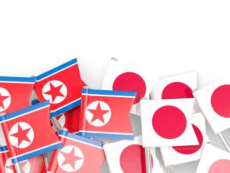 Flag pins of North Korea (DPRK) and Japan isolated on white. 3D illustration