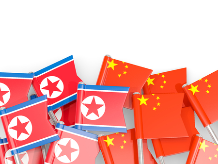 Flag pins of North Korea (DPRK) and China isolated on white. 3D illustration