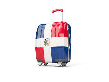 suitcase packing: Luggage with flag of dominican republic. Suitcase isolated on white. 3D illustration