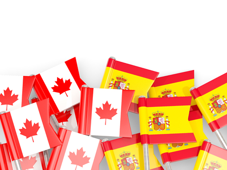 Flag pins of Canada and Spain isolated on white. 3D illustration