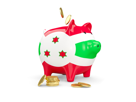Fat piggy bank with fag of burundi and money isolated on white. 3D illustration