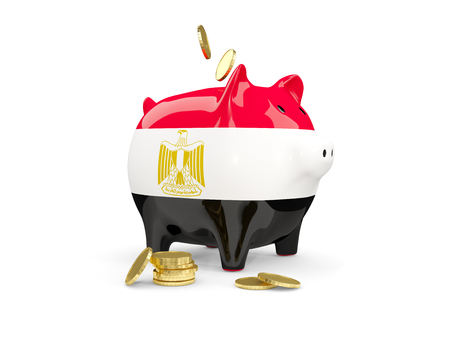 Fat piggy bank with fag of egypt and money isolated on white. 3D illustration