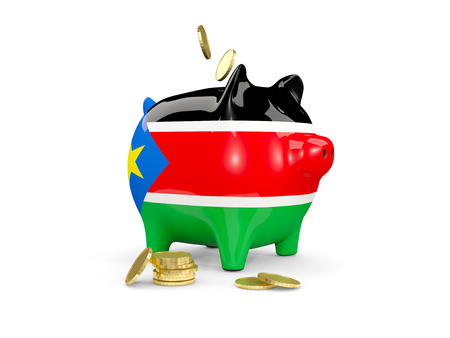 Fat piggy bank with fag of south sudan and money isolated on white. 3D illustration