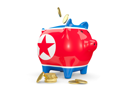 fag: Fat piggy bank with fag of korea north and money isolated on white. 3D illustration