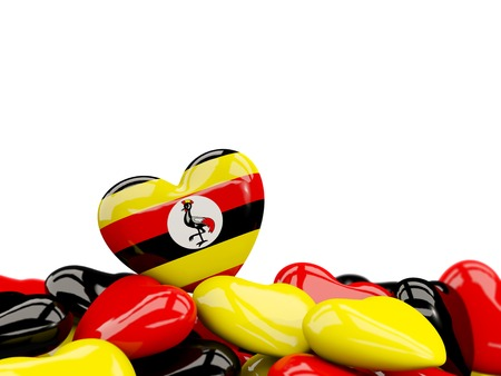 Heart with flag of uganda on top of colourfull hearts isolated on white. 3D illustration