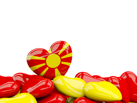 Heart with flag of macedonia on top of colourfull hearts isolated on white. 3D illustration