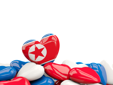 Heart with flag of korea north on top of colourfull hearts isolated on white. 3D illustration