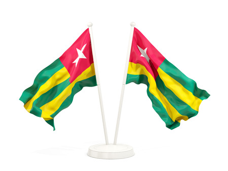 Two waving flags of togo isolated on white. 3D illustration