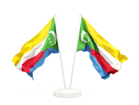 Two waving flags of comoros isolated on white. 3D illustration