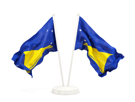 Two waving flags of tokelau isolated on white. 3D illustration