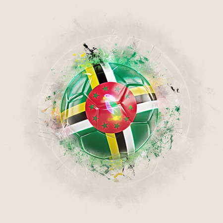 Grunge football with flag of dominica. 3D illustration