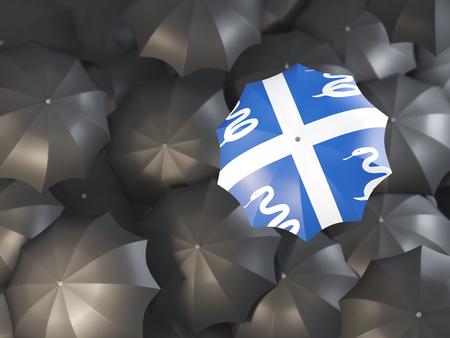 Umbrella with flag of martinique on top of black umbrellas. 3D illustration Stock Photo