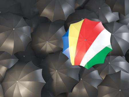 Umbrella with flag of seychelles on top of black umbrellas. 3D illustration