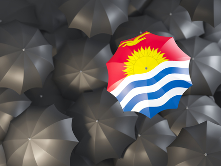 Umbrella with flag of kiribati on top of black umbrellas. 3D illustration