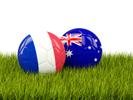 France vs Australia. Soccer concept. Footballs with flags on green grass. 3D illustration