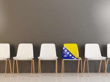 Chair with flag of bosnia and herzegovina in a row of white chairs. 3D illustration