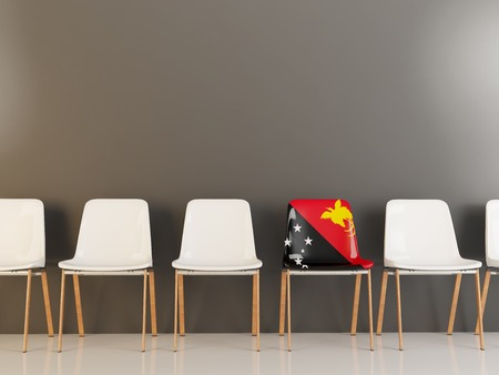 Chair with flag of papua new guinea in a row of white chairs. 3D illustration Stock Photo